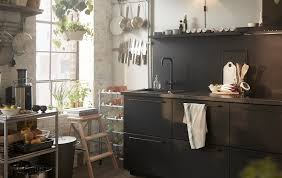 Beautiful wooden kitchen cupboards design ideas for comfortable kitchen Farmhouse Kitchen Black Kitchen Cupboards With Sink Metal Trolley And Utensils Stored On Rails By Mdeca Group Ideas Ikea