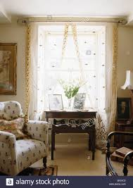 Patterned Curtains Living Room Cream Patterned Armchair In Small Cottage Living Room With Antique