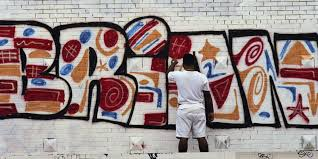 giuliani s broken windows theory deserves more criticism a flushing resident paints a memorial sign thursday on sept 6 1990 in new york for brian watkins of provo utah who was murdered in a new york subway
