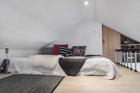 Slanted Roof Bedroom Serenity And Elegance Feel Right At Home In A Monochromatic Attic