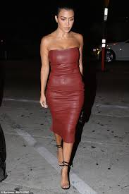stunner kourtney kardashian flaunted her enviable curves in a skin tight leather dress while