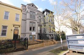Developers are converting the single-family home at 1514 Q St. NW into four  condo units. Brian Kapur/The Current