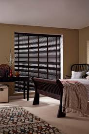 find great range bedroom. dark wood and pattern create a cosy global look in room plain cream find great range bedroom