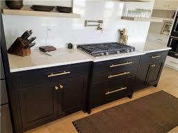 painted maple cabinets quartz countertop and backsplash