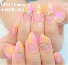 Ginza Bonny旭川店さんのネイルデザイン ピンクとオレンジのダブル