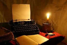 candle old typewriter and old book