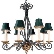 green patina iron chandelier with gold leaf details for