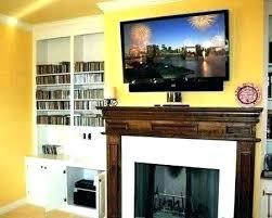 tv mounting on fireplace best mounts fireplace wall mount wall mount over fireplace ideas mounting a