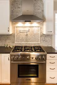 What Color Backsplash With White Cabinets Mesmerizing White Kitchen With Marble Subway Tile And Tile Backsplash Over Stove