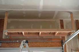 diy how to build suspended garage storage shelves diy building an overhead garage storage shelf