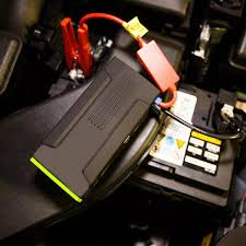 Image result for image of power bank jump starter on car
