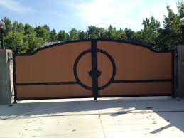 wondrous oak wooden driveway gates with curved top also black iron fences as front yard views and landscape ideas added cement concrete pavers installations