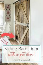 learn how to build a sliding barn door complete with a pet door