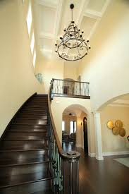 cool foyer chandeliers in entry terranean with wood floor stairs next to foyer chandelier alongside two story