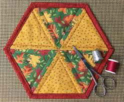 Quilted Potholder Tutorial: Instructions & Patterns to Try & ... Quick Weekend Project: FREE Hexagon Mug Rug Pattern ... Adamdwight.com