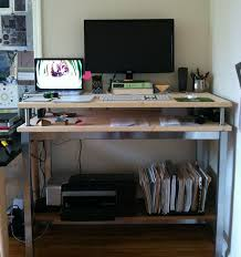 today i join the ranks of those working standing up inspired by this ikea standing desk i fashioned a similar one specifications below