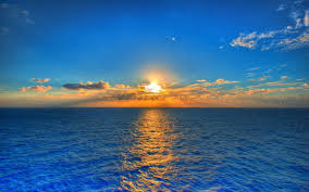 sunset on blue sea water to view