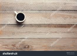 wood table top view. cup of coffee on wooden table, top view wood table c