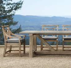 view in gallery concrete and teak trestle table from restoration hardware