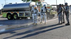 photos firefighters from the 442d fighter wing prepare to hose down security forces members who have just