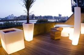 rooftop furniture. Glowing Outdoor Seating And Planters Are Perfect To Make Your Terrace More Glam. Rooftop Furniture
