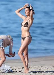 Blonde removes oily bikini