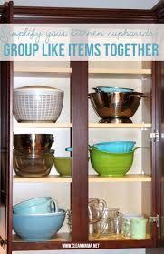 simplify your kitchen cupboards group like items together via clean mama