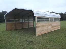 we decided we wanted natural light in our barn so we added clear corrugated roofing for windows on the sides the area between the metal posts is about 20