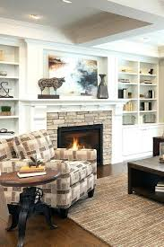 unique built stone fireplace with built ins white trim molding packed throughout stone fireplace with white built ins