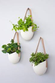 Set of 3 porcelain and leather hanging containers by light + ladder |  Styled Canvas Blog | Pinterest | Ceramic wall planters, Porcelain and  Planters