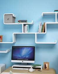 wall shelving branch in white above computer