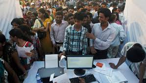desperate for jobs s graduates are working as drivers n youths seeking jobs crowd a job fair in mumbai wednesday oct