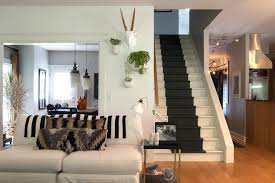 stairs in living room living room eclectic with black side table white sofa wall planter indoor