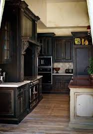 Distressed Kitchen Furniture Distressed Black Kitchen Cabinets With White Countertop And Silver
