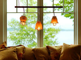 copper pipe chandelier mismatched glass lampshades are strung from a copper pipe to make