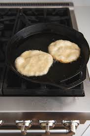 an image of pan fried bread in a skillet full of hot oil for making navajo