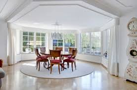 wooden round dining table white round rug metal pendant lamp cozy dining room design image