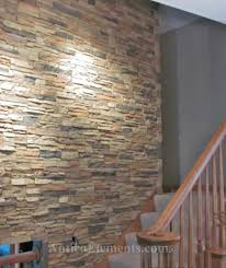 stairway with faux stone wall panels