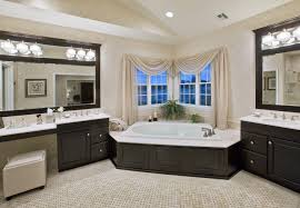 beautiful master bathroom with a corner tub accompanied by two vanities at monmouth chase nj chelsea savannah home design