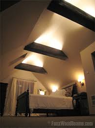 open beam ceiling lighting. A Bedroom\u0027s Vaulted Ceiling With Exposed Beams Beautiful Light Installation. Open Beam Lighting