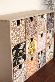 DIY A Ikea MOPPE Box is transformed with vintage adorable mixed wallpaper by