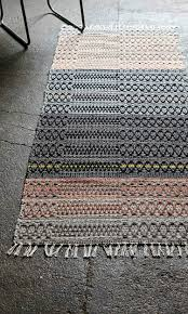 clandestino rug from plumo in shades of soft pink and grey
