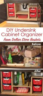 from a single sheet of plywood and some dollar bins she built this fabulous organizer what a great way to use all that awkward space under the sink