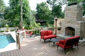 backyard deck with stone fireplace