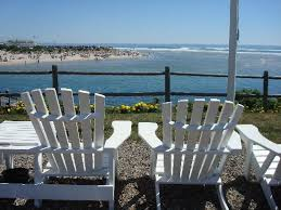 adirondack chairs on beach. Sea Chambers Motel: Adirondack Chairs Overlooking The Beach On