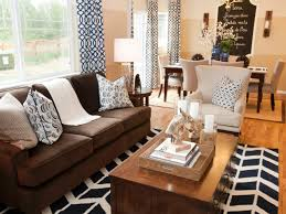brown and white rug. Bold, Graphic, Black-and-white Patterned Curtains, Pillows And A Rug Brown White
