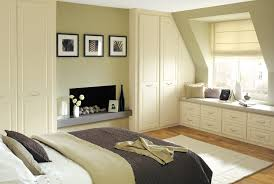 Appealing Bedroom Cupboards Ideas With Wooden Flooring And White Wall Paint  And White Carpet Area And