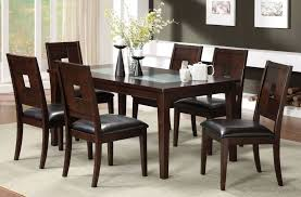 rustic dining table in dark walnut color with ed glass and chairs in dining room