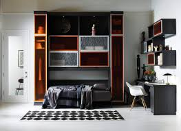 a multifunctional horizontal wall bed and home office combination allows guests to feel comfortable when they visit and provides a workable space throughout