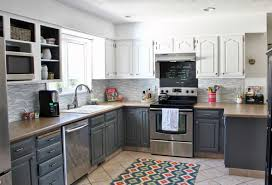 grey wood kitchen cabinets design with brown granite and black appliances